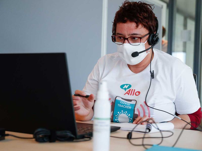 An operator works in a call center dedicated to COVID-19 (novel coronavirus) tracing.