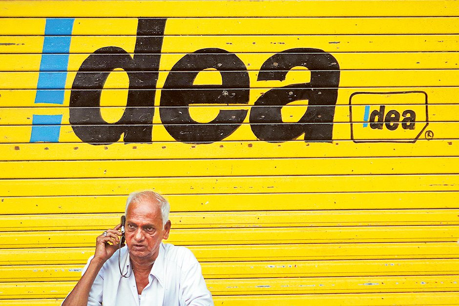 A man speaks on his mobile in Mumbai. Vodafone would gain a listing in India after the merger with Idea Cellular Ltd.