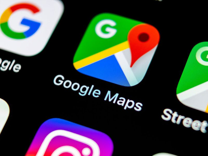 Google Maps application icon on Apple iPhone X screen.