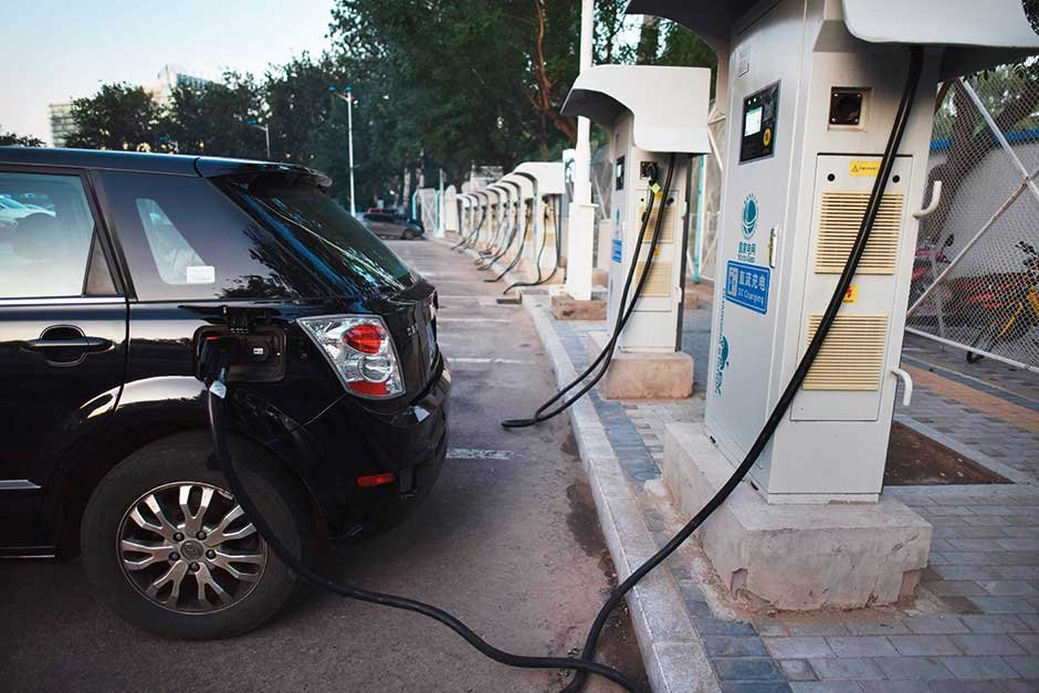 An electric car at a charging station in Beijing. China's move to phase out  petrol and diesel cars augurs well for the nation which is plagued by pollution.