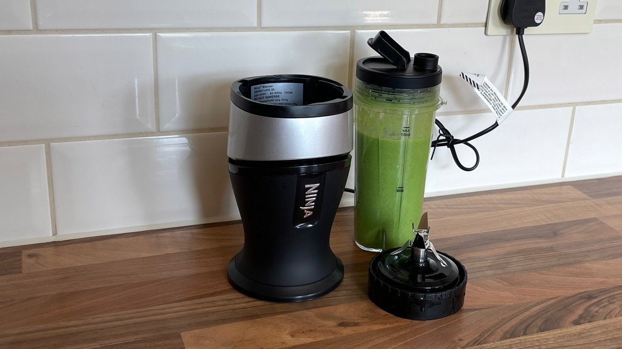 Ninja Personal Blender and Smoothie Maker QB3001 filled with a msoothie created by blending fruit and vegetables